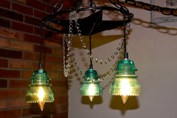 Reuse of Glass insulators by WolfeInnovations