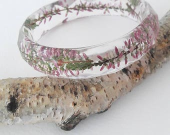 Bracelet in which sprigs of Heather filled transparent resin.