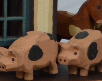 Hand Carved wooden pigs
