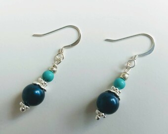 Earrings with blue beads