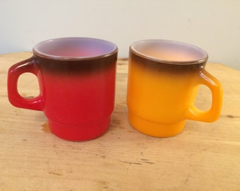 Set of two vintage red and yellow Fire King milk glass coffee mug tea cups great mid century design!