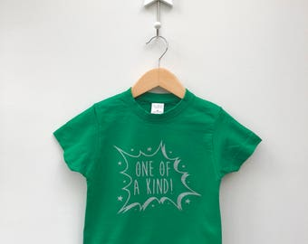 Light Your Spark Green Children's T-shirt with 'One of a Kind' design in silver