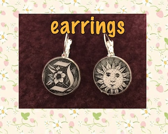 SALE 2.00 OFF   earrings with BW images, sun on one and initial I or T on the other, 3/4 inch