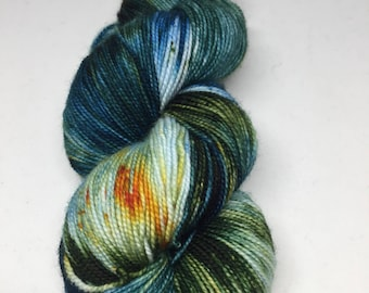 Hand dyed sock yarn in teal, dark green and blues. Super wash Marino and nylon sock yarn inspired by Canyon Lake.  Sock yarn hand dyed