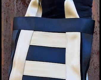 Golden seatbelts handbag