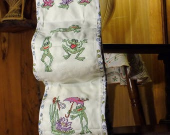 WORN toilet TISSUE rolls embroidered PT cross: between frogs