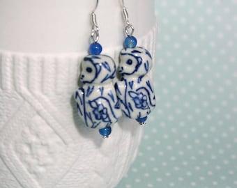 White and blue porcelain monkey earrings