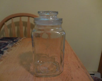 Vintage 1960s to 1970s Clear Glass Fleur De Lis Pressed Anchor Hocking Jar With Airtight Lid Storage Kitchen Canister Square