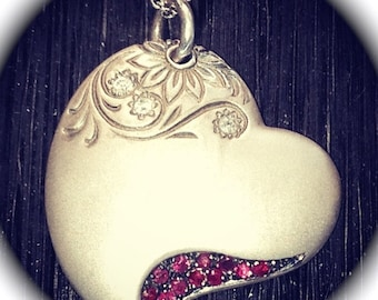 Hand engraved Sterling Silver heart necklace with Diamonds and Rubies.
