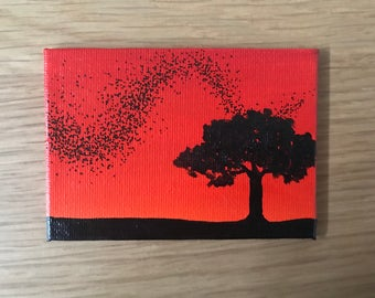 Red sunset with murmuration and tree in silhouette   magnet   hand-painted gift
