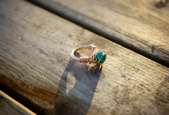 Rose-gold coloured copper wire-wrapped statement ring of turquoise pearl bead, size N