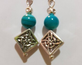 Silver drop earring with teal glass bead and Celtic knot
