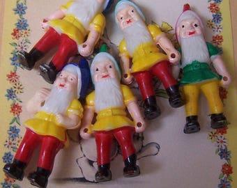 five little plastic gnomes