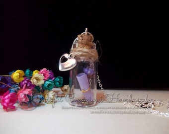 Love message and flower in a bottle