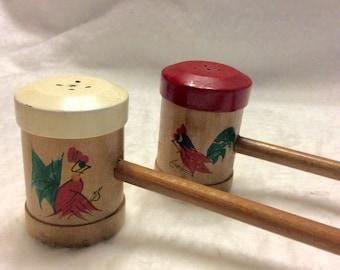 Vintage 1940's long wood handle made in Japan salt pepper shakers .