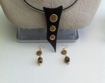 Ebony necklace and gold leaf