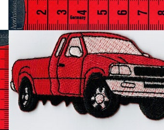 Pick up iron or sew red coat. Patch applique