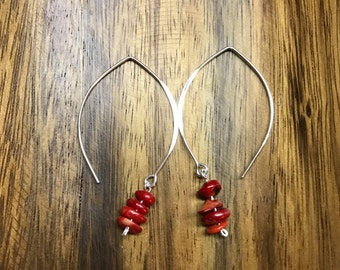 Red bamboo coral chips on a silver wish bone ear wire