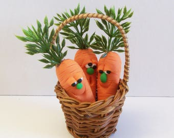 Miniature wicker basket filled with carrot faces: Spring table top or tree decoration