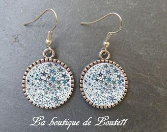 Cabochon image earrings blue stars