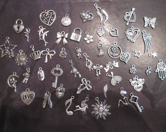 x 50 mixed silver charms 50 different patterns #E