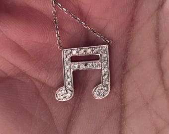Diamond pave sixteenth misic note necklace
