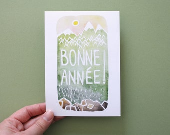 Happy new year : Mountains wish card. French. Green background, nature. watercolor. A6 card and its envelope