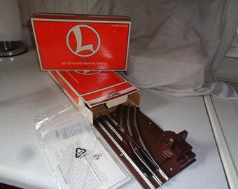 Pair of Lionel manual switches in boxes
