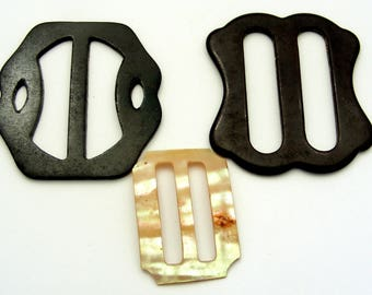 Art deco mother of pearl and early plastic or bakelite belt buckles