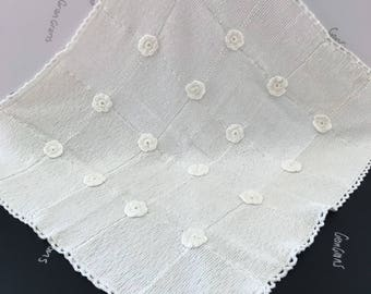 Gorgeous white baby blanket, throw, decorator item. Hand knitted with crocheted flowers