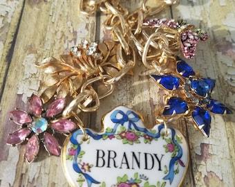 Vintage assemblage necklace/ brandy liquor label/ statement piece