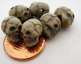 4 Tiny High Fired Skulls - vertical