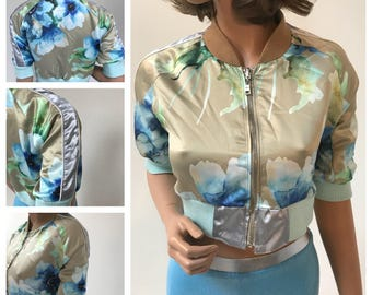 Maggie Barry One of a kind sample  Silky fabric floral print, cropped bomber jacket. Ribbed arm cuffs and waistband. SMALL