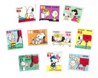 10 x Peanuts Snoopy Japanese used postage stamps - off paper all different - Japan - for crafts, stamp collecting, card making, scrapbook