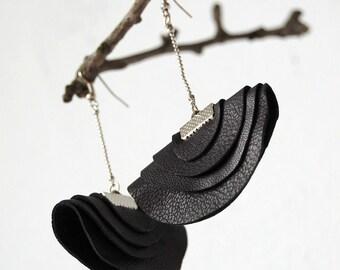 Elegant eco friendly handmade earrings .