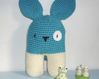 The toy bipedal turquoise hand crocheted