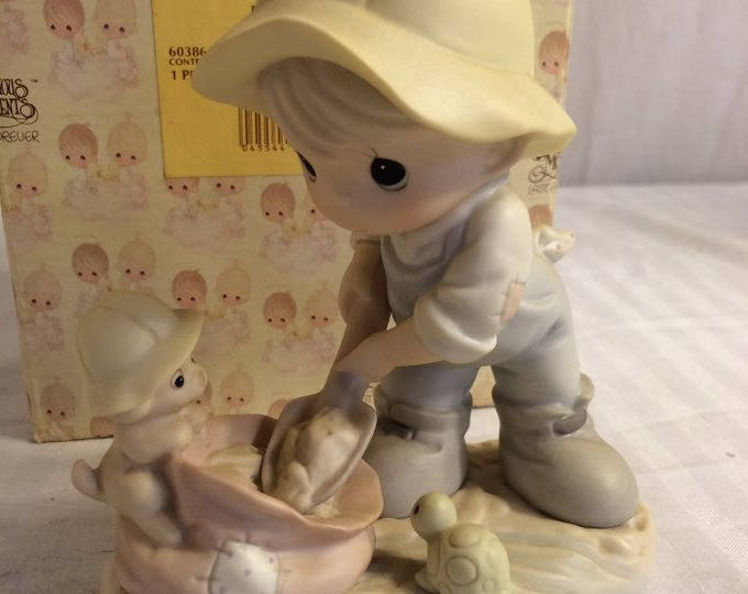 "Precious Moments Figurine ""Nothing can dampen the spirit of caring"" in the original box, excellent condition w/ reduced shipping"