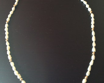 Delicate pearl and gold bead necklace