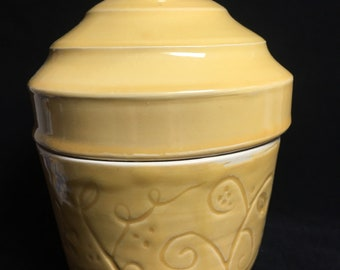 Yellow carved covered box