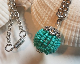 """Turquoise beaded ball charm necklace. 28"""""""
