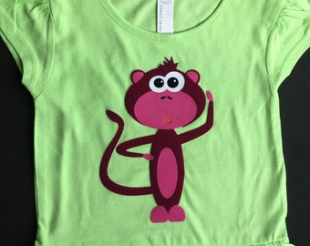 The cutest monkey ever on a little girl's ruffled T-shirt