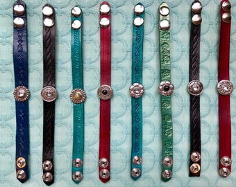 Leather bracelets with crystal and stone accents.