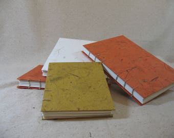 White Watercolor Journal (shown here in middle).  Item # 3004.