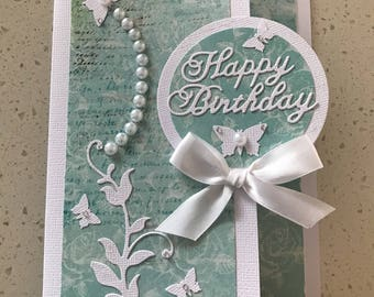 Handmade Birthday card in pale green and white with pearls and butterflies.