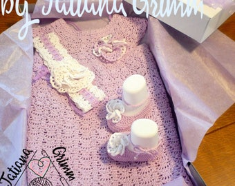 A crocheted christening ensemble: gown, shoes, and headband.
