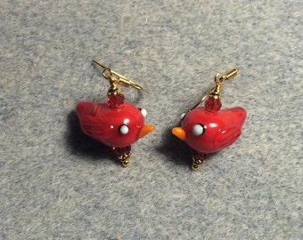 Red lampwork cardinal bead earrings adorned with red Chinese crystal beads.
