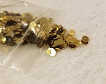 Round gold sequins