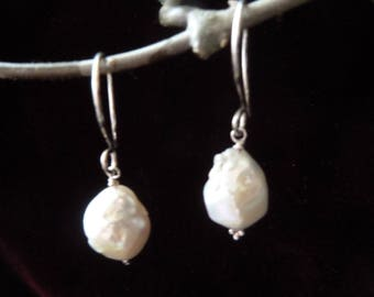 Sterling Silver and nice plump Freshwater Cultured Pearls.