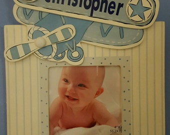 Sweet personalized airplane picture frame and hook.  Customize with your child's name.  Holds 4 x 4 picture.  Airplane themed.  New baby.