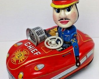 Tinplate Fire Chief and car-clockwork. 1960s Japanese made Yoshiya K.O.